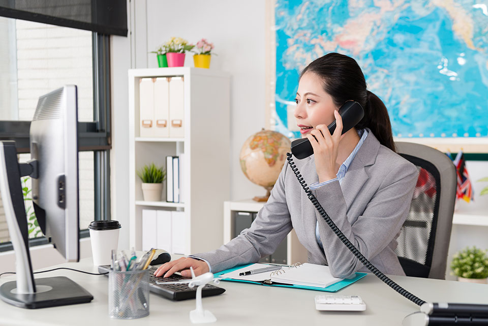 A woman talking on the phone in her office